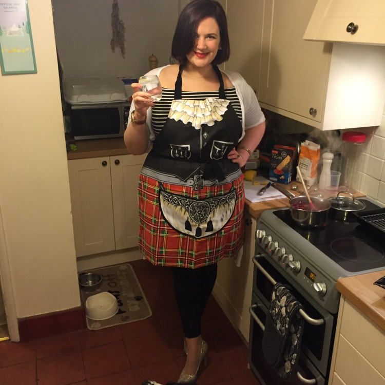 Curvy Girl Thin in scottish apron with gin